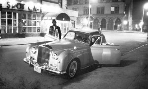 Thelonious Monk and Baroness Nica de Koenigswarter get into her Bebop Bentley outside the Five Spot cafe, New York, 1964