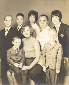 Pat Conroy in his Citadel uniform with his mother and siblings