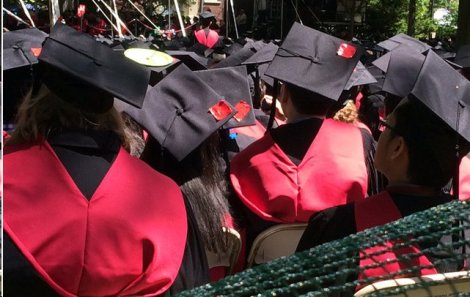 At today's graduation ceremonies, Harvard graduates wore crimson tape on their mortarboards to protest sexual assaults.