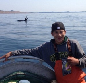 Jaylen Fryberg with orca whales swimming in Puget Sound