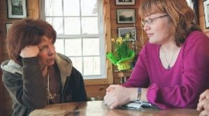Kit Gruelle and Deanna Walters meeting at Kit's cabin in a scene from Private Violence
