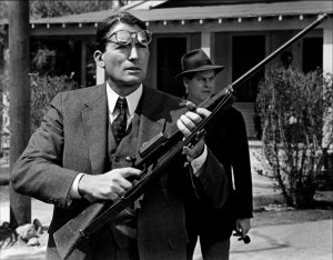 Atticus shooting a rabid dog in To Kill a Mockingbird